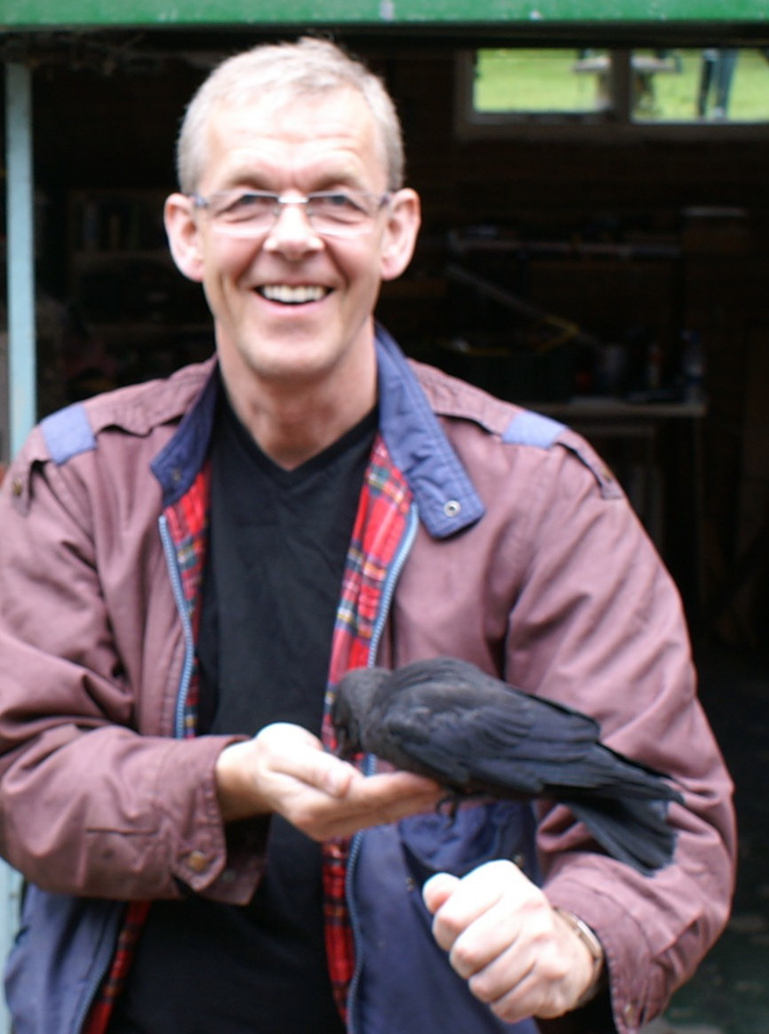 Andy holding a crow in his hand